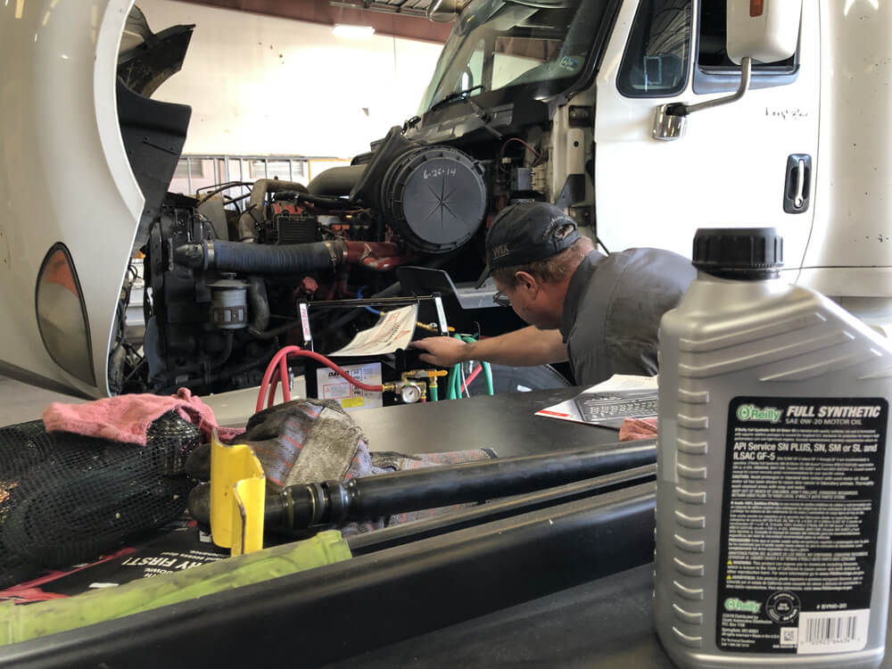 Mechanic doing Regular Truck Maintenance